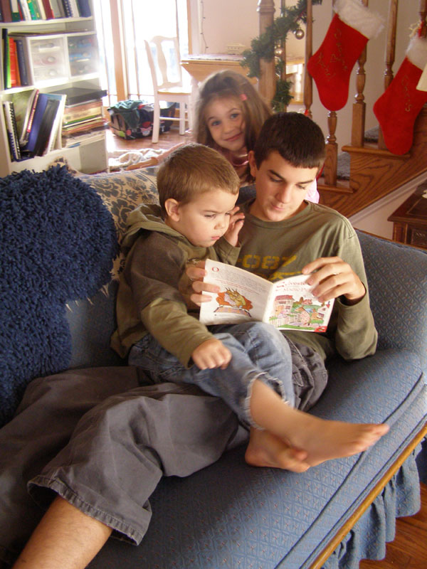 Siblings reading together.